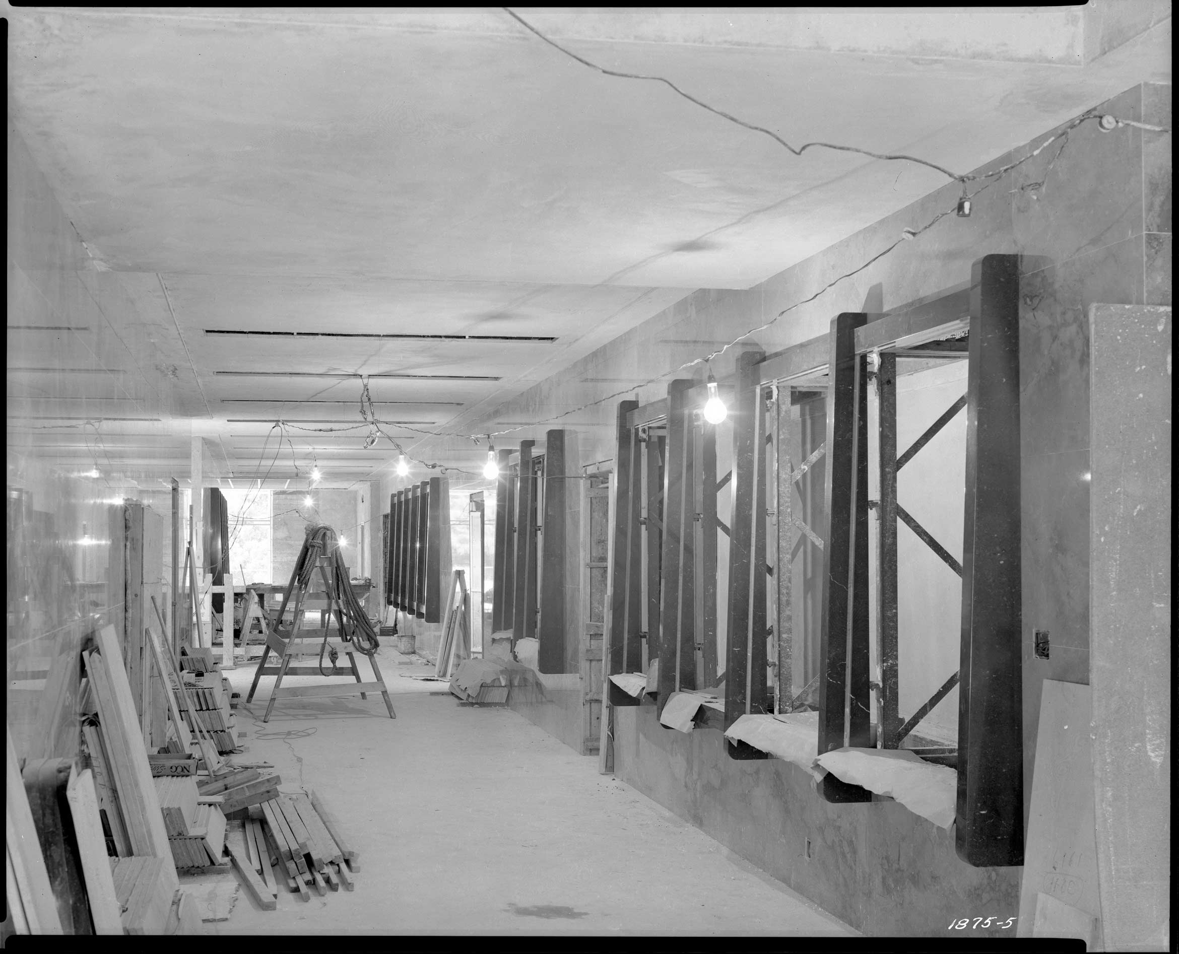 Capitol annex first floor interior showing county exhibit niches under construction september 1950 black and white photo